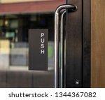 restaurant door handle with... | Shutterstock . vector #1344367082