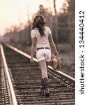 Young Girl Walking Along...