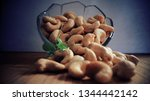 cashew nuts close up | Shutterstock . vector #1344442142