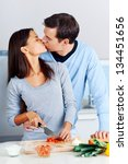 couple prepare food together in ...