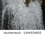 isolated waterfall in tropics | Shutterstock . vector #1344524852