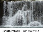 isolated waterfall in tropics | Shutterstock . vector #1344524915