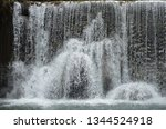 isolated waterfall in tropics | Shutterstock . vector #1344524918