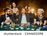 poker players sitting around a... | Shutterstock . vector #1344603398
