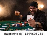 man is playing poker with a... | Shutterstock . vector #1344605258