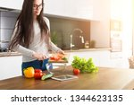young trendy woman cooking... | Shutterstock . vector #1344623135