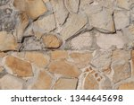 texture of a stone wall. old... | Shutterstock . vector #1344645698