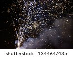 fireworks and it's smoke at... | Shutterstock . vector #1344647435