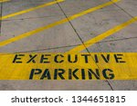 Small photo of Executive Parking sign may create a separation between top management and employees. Dedicated parking spot for company executives may negatively undermine company morale