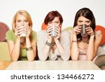 young women drinking coffee | Shutterstock . vector #134466272