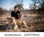 Caucasian Man Posing With Lion...
