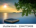 sunset over lake muskoka in... | Shutterstock . vector #1344773408