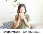 women sitting in white room... | Shutterstock . vector #1344828368