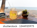lemon and honey drink with... | Shutterstock . vector #1344935975
