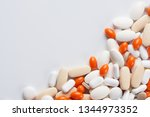 multicolored pills background... | Shutterstock . vector #1344973352