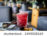 bramble alcohol cocktail on the ... | Shutterstock . vector #1345028165