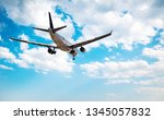 airplane on blue sky and cloud... | Shutterstock . vector #1345057832
