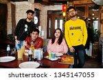 group of asian friends sitting... | Shutterstock . vector #1345147055