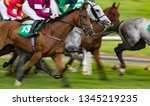 Stock photo motion blur horse racing action 1345219235