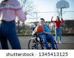 teenage boy in wheelchair...   Shutterstock . vector #1345413125
