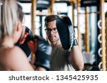 young woman on kickboxing... | Shutterstock . vector #1345425935