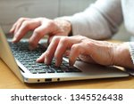 mature female hands typing text ... | Shutterstock . vector #1345526438