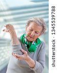 elbow pain injury  old woman... | Shutterstock . vector #1345539788