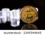 Golden Bitcoins In The Ice Cub...