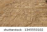 hieroglyph texture from egypt... | Shutterstock . vector #1345553102