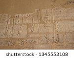 hieroglyph texture from egypt... | Shutterstock . vector #1345553108
