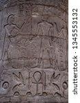 hieroglyph texture from egypt... | Shutterstock . vector #1345553132