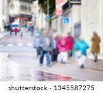 city in the daytime and passers ... | Shutterstock . vector #1345587275