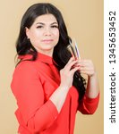 girl makeup face hold tweezers... | Shutterstock . vector #1345653452