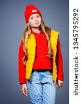 a funny girl in bright casual... | Shutterstock . vector #1345795292