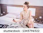 a cute girl sitting in a lace... | Shutterstock . vector #1345796522