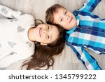 cute boy and girl are lying on... | Shutterstock . vector #1345799222