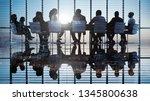 business people in a board room ... | Shutterstock . vector #1345800638