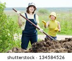 two women works with animal... | Shutterstock . vector #134584526