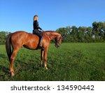 Small photo of Unsaddle horseback riding in sunset