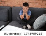sad african american boy crying ...   Shutterstock . vector #1345959218