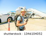 a young traveling man get in...   Shutterstock . vector #1346104052