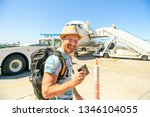 a young traveling man get in...   Shutterstock . vector #1346104055