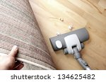 Vacuuming Under Carpet