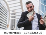 portrait of businessman holding ... | Shutterstock . vector #1346326508