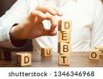 businessman removes wooden... | Shutterstock . vector #1346346968