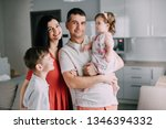 portrait of young happy family... | Shutterstock . vector #1346394332