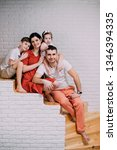 portrait of young happy family... | Shutterstock . vector #1346394335