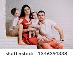 portrait of young happy family... | Shutterstock . vector #1346394338