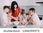 young family preparing food in... | Shutterstock . vector #1346394572