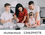 young happy family cooking... | Shutterstock . vector #1346394578